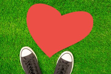 Valentine's Day love concept, sneakers with Heart on grass