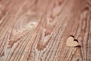 Little heart figure on wooden background