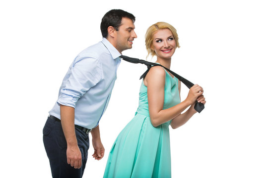 Woman pulling man for his tie