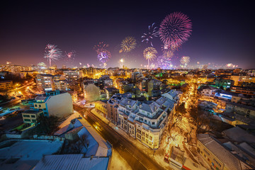 Downtown Varna cityscape with many flashing fireworks celebratin