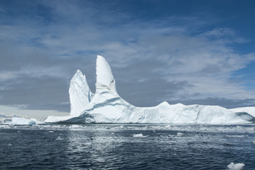 large iceberg in Antarctic waters against the backdrop of the An