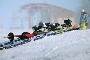 Detailed view of the ski bindings and skis lying on the piste