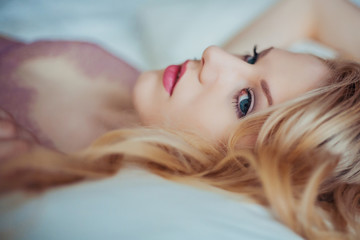 Portrait of young beautiful woman in seductive lingerie.
