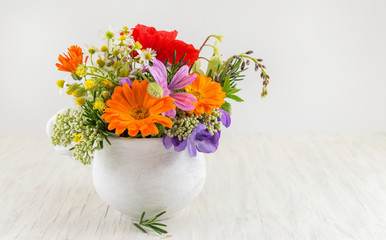 Decorative flowers in a white vase