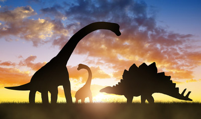 Silhouette of dinosaurs in the sunset. Wall mural