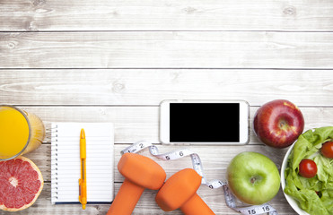 Fitness Background with Smartphone and Healthy Diet Food