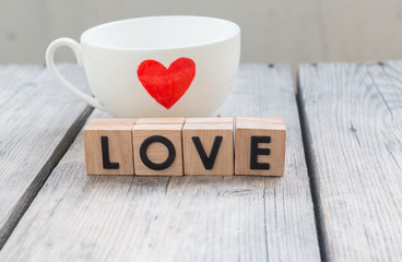 """Cup of love with words """"Love"""" from wooden cubes  , people, relat"""