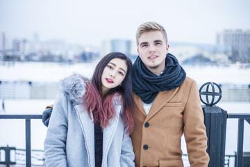Portrait Couple asian beautiful girl and caucasian boy (russian) in winter weather