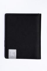 Black leather book on white backround.