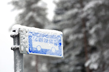 Bus Stop Sign in Winter Snow