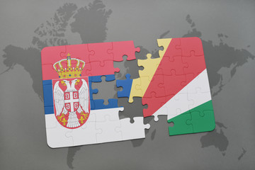 puzzle with the national flag of serbia and seychelles on a world map