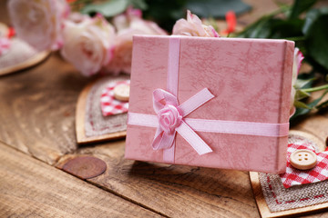 Gift box, heart shapes and roses