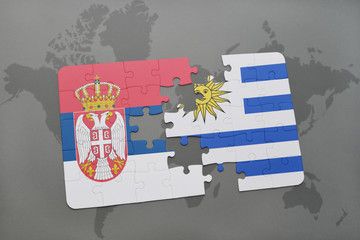 puzzle with the national flag of serbia and uruguay on a world map