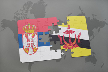 puzzle with the national flag of serbia and brunei on a world map