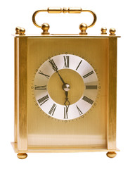 Brass carriage clock at 5 minutes before the hour