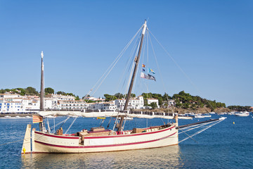 Tourist boat in the port of Cadaques, Costa Brava, Girona province, Catalonia