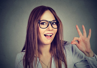 Successful teenager. Nerdy funny woman showing ok sign