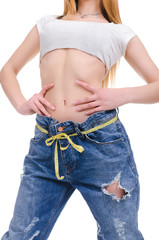 Diet.Young Girl in blue jeans large size on a white background