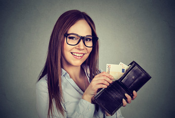 Woman taking out money euro banknotes from wallet