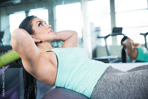 healthy woman doing situps on exercise ball during gym workout stock photo and royalty free. Black Bedroom Furniture Sets. Home Design Ideas