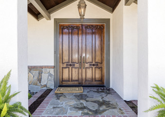 Double House Front Door made out of wood.