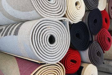 close up on stacking carpet rolls