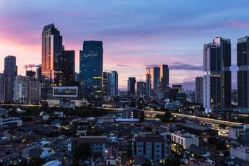 Jakarta sunrise over modern skyline  in Indonesia capital city