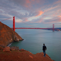 A Man is Looking at Golden Gate Bridge, California, USA