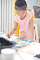 Little girl painting in art class