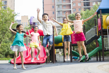 Happy children playing in park
