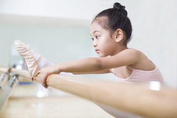 Little girl practicing ballet