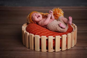 cute newborn baby in the basket