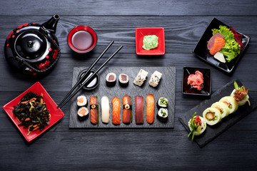 Sushi set on black background top view