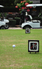 Tee off with golf cart on golf course