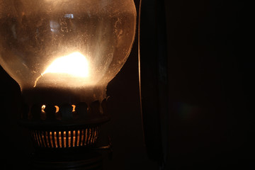 Old lamp illuminates darkness of the night.