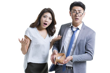Shocked young couple with empty wallet