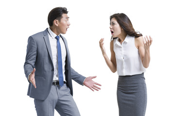 Shocked young business people against white background