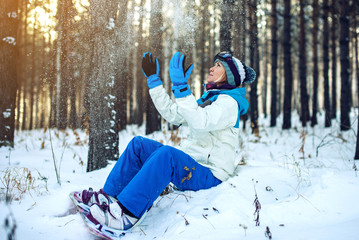 woman snowboarder with snowboard is resting sitting on the snow