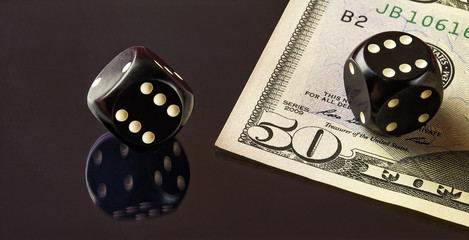 Cubes for poker and a part of the fifty-dollar notes lying on th