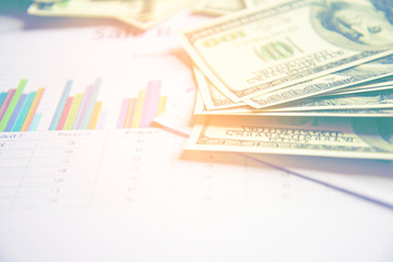 Business concept with money and documents graph, report finance.