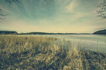 Wild lake landscape, moody image toned, vintage photo