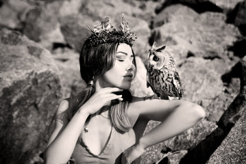 American native indian woman with owl on stone background. Vintage, retro style
