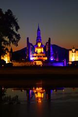 Fotomurales - sukhothai historical park illuminated in the night, Thailand