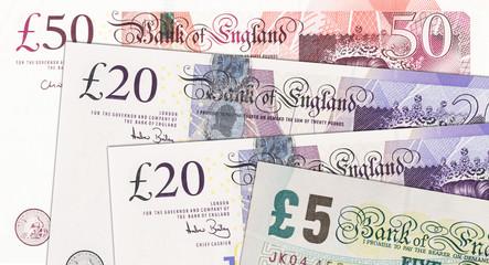 British pound bills background. British Pound is the currency of the United Kingdom