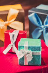 Stack of colorful gift boxes close up