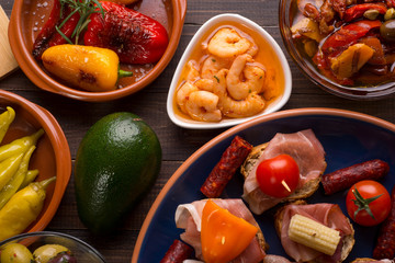Spanish tapas starters on wooden table