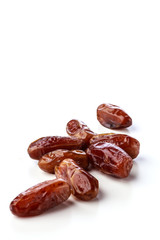 Fresh brown dates with seeds on a white background