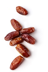 Fresh brown dates with seeds on a white background top view