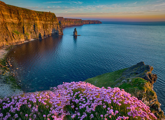 Ireland countryside tourist attraction in County Clare. The Cliffs of Moher and castle Ireland. Epic Irish Landscape Seascape along the wild atlantic way. Beautiful scenic nature hdr Ireland. Wall mural