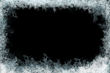 Frostwork. Decorative ice crystals frame on black matte background